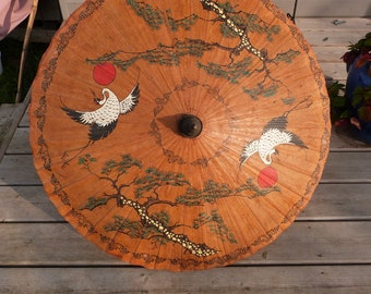 Japanese rice paper and bamboo Parasol, hand painted with cranes and trees and the rising sun, circa 1940s.