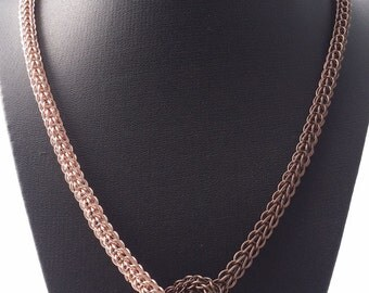Knotted rose gold and brown metal necklace in the full persian chain maille weave