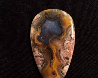 Yellow banded agate cabochon