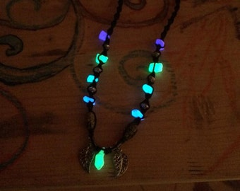 Lime green glowing pendant with blue, turquoise, and purple glowings beads.