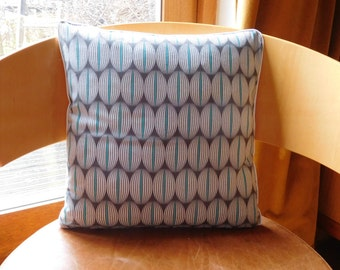 abstract geometric design cushion in charcoal, cream and turquoise