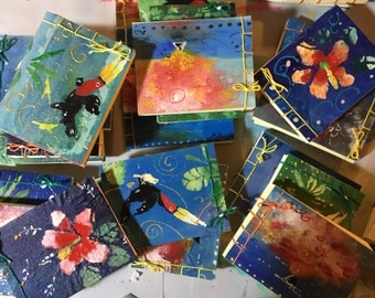 Notebooks made completely by hand, cheerful and colourful!