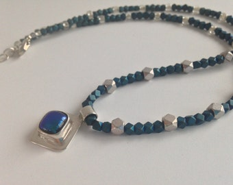 blue dichroic glass in sterling silver pendant on beaded necklace