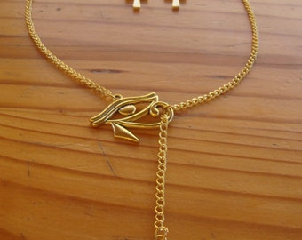 "Adornment ""Golden Egypt"" Ankh and eye of Horus (necklace and earrings)."