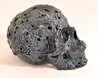 Scull ornamental. dark grey. porcelain