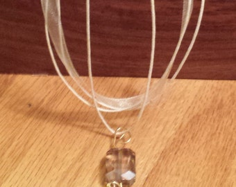 Ivory Ribbon Necklace With Light Brown Tinted Glass Bead
