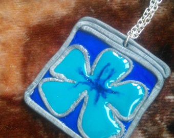 Enamelled flower pendant