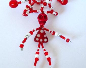 Red and White Polka-Dot Beaded Skull Figure