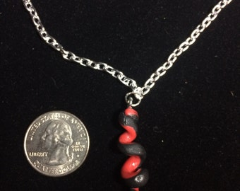 """Red and black spiral pendant on 18"""" chain"""