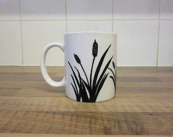 Mug with hand painted bull rushes design