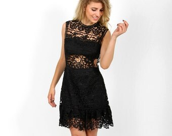 Dress of lace black with transparencies