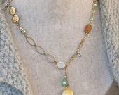 Gold locket necklace /bohemian/crystal/charm. Tiedupmemories