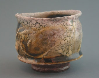 Teacup, wood-fired iron rich stoneware with crawling shino, tenmoku and natural ash glazes