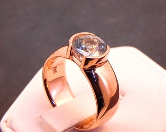 AAA Rare Blue Round Aquamarine   6.70mm  1.20 Carats   in 14K rose gold ring. 1020