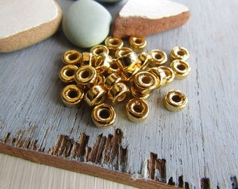 gold ceramic beads, gold rondelle beads, metalized, small spacer discs washers, plated  6mm x 3mm ( 20 beads ) 6asrmm-3