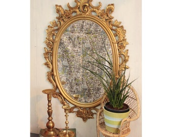 ornate mid century wall mirror - large gold oval framed mirror - Hollywood Regency