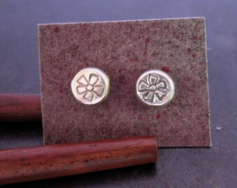 Funky flower post earring pair -  Two little sterling silver stud earrings with flower stamp
