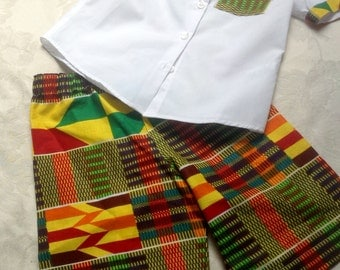 African Kente boy's outfit of white trimmed shirt and kente shorts