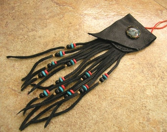 "Black deerskin leather neck pouch with a teal and red glass mandala charm, 6"" long fringe beaded with trade beads, 32"" red nylon neck cord"