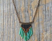NEVADA CITY. Hand beaded glass and wood necklace on brass chain.