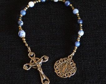 One decade Catholic Rosary, Open Decorative Crucifix, Mary Many Flowers medal, Sodalite beads.