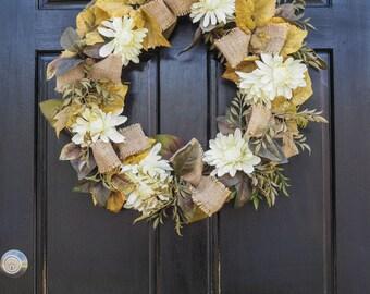white flower wreath, burlap, autum, gold leaves, green, brown