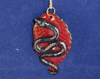 Multicolor iridescent snake on a red leaf pendant