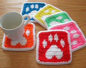 Paw Print Coasters. Colorful crochet coaster set with dog paw prints. Pet lover mug rug