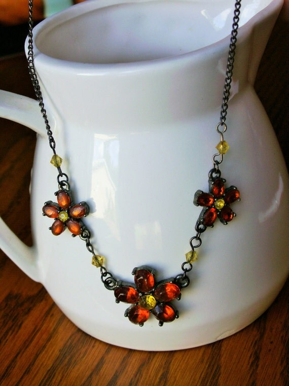 orange and gold flower necklace with 16 inch metal chain