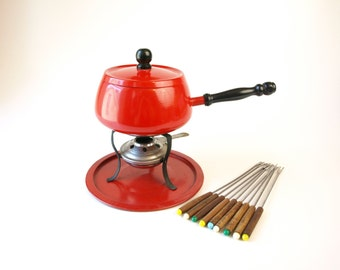 Vintage red fondue pot with 9 skewers