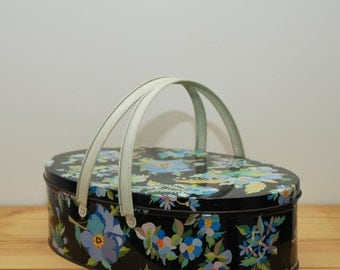 Vintage basket tin with handles, black with blue floral pattern, Pansies, oval biscuit tin with lid