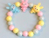 Kawaii Bunny Friends - Pastel Iridescent Pearl Stretch Bracelet with Colorful Rabbit Charms