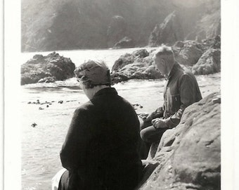 Old Photo Woman and Man at Beach sitting on Rocks Rear View 1930s Photograph snapshot vintage