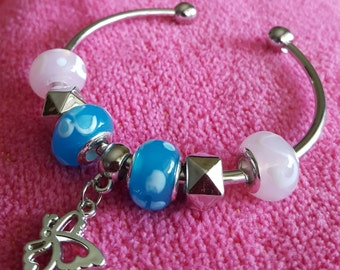BRACELET: Fashionable Silver Cuff Bracelet with Blue and White Lampwork Beads and a Darling Butterfly Charm