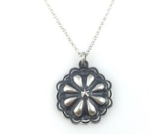 Silver Disc Pendant star flower design.