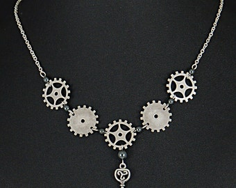 Elegantly simple silver plated brass steampunk gear necklace with key and hematite beads by Sylvan Creations.