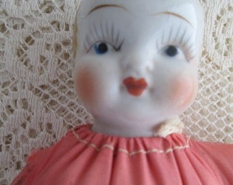 Antique Porcelain Hand painted Doll Head Looking For A Home To Be Loved Again