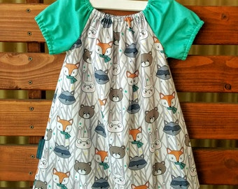 Girls Peasant Style Dress. Woodland Friends Faces. Sizes 1,2 and 4.