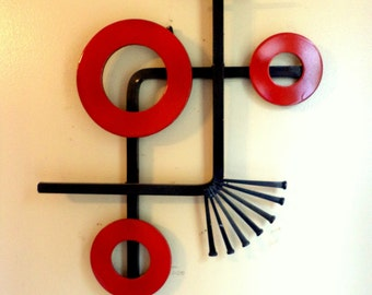 Abstract metal wall art with three red circles