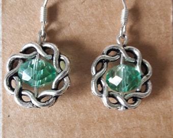 Handmade green bead in silver frame earrings