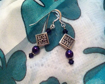 Purple and silver pierced earrings with Celtic knot beads.