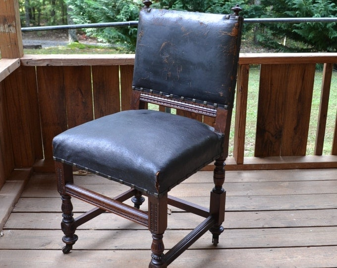 Vintage Wooden Desk Chair Black Leather Seat and Back Ornate Wood Design Weathered Worn Rolling Spanish Revival Office PanchosPorch