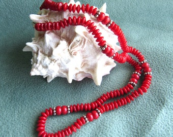 Red coral necklace with sterling silver.  Discs shape and drums with sterling accent beads, lobster clasp sterling, 17 1/2 inch length.