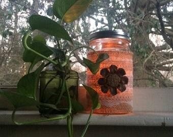 Mason Jar candle lantern with pine cone button flower