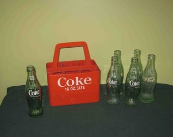 Vintage Coca Cola 6 Bottle Red Plastic Carrier Very Collectible With 6 Coke bottles-6 1/2 Fl. Oz.