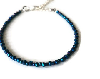 Bracelet with dark blue faceted beads and Toho seed beads / Delicate beaded bracelet