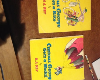 Curious George vintage books Rides a Bike and Gets a Medal
