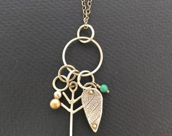 Talisman Necklace with riveted leaf, arrow and turquoise.