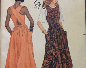 Butterick 4913 - 1990s Sleeveless Dress with Criss Cross Back Straps and Flared Midi Length Skirt - Size 6 8 10 12