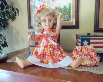 SALE****TWO Beautiful Dresses/Talking Doll With Blue Eyes is FREE